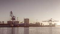 Cranes unload cargo in a seaport in Sweden