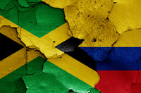 flags of Jamaica and Colombia painted on cracked wall