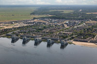 Aerial view Dutch village Huizen at lake with apartment buildings
