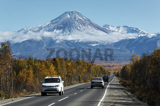 Cars driving on road to Avachinsky Volcano on Kamchatka