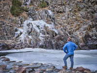 senior male hiker in a canyon of mountain river i