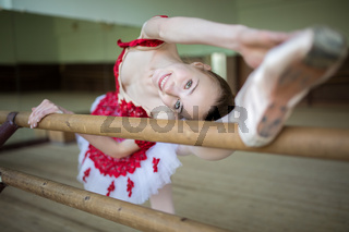 Portrait of a ballerina that makes stretching