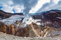 Dramatic volcanic landscape, caldera of active volcano: hot spring, fumarole, lava field, gas-steam activity in crater. Mountain landscape, travel destinations