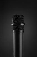 Wireless Black microphone on dark grey background