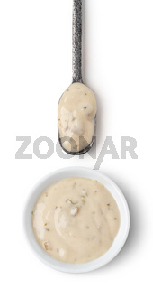 Bowl and spoon with mushrooms sauce
