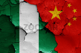 flags of Nigeria and China painted on cracked wall
