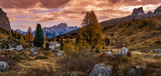 Overcast morning autumn alpine Dolomites mountain scene. Peaceful view near Valparola and Falzarego Path, Belluno, Italy.