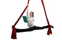 Formal woman on aerial silks reading documents