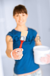 woman with paintbrush and paint pot