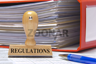 regulations marked on rubber stamp