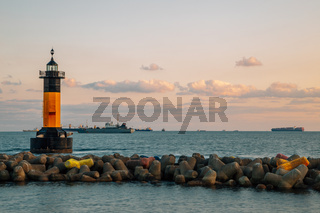 Sunset of Songdo beach, lighthouse and breakwater in Busan, Korea