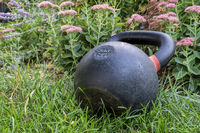 kettlebell on grass - backyard fitness