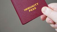 immunity pass or passport - hand holding mock-up european immune certificate travel document
