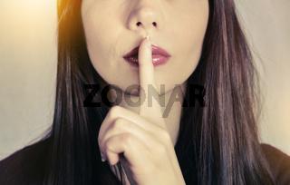 secret quiet lips woman finger index silence pst