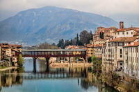 bassano del grappa, italy - 03/17/2019 - panorama of the old town with covered wooden bridge