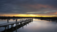 Jetty on lake neusiedlersee in Burgenland at sunrise