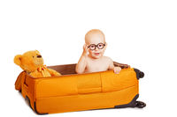 The little boy сидиит in a suitcase it's isolated on white
