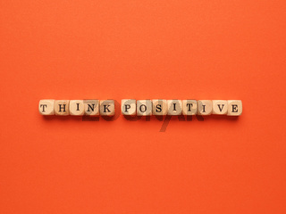 Think positive written with small wooden blocks