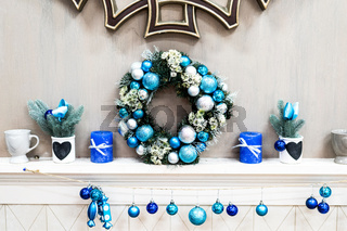 Inspiring New Year Interior With Christmas Wreath Of Small Colored New Year Decorations On White Commode. Family Holiday Atmosphere