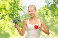 happy smiling young woman with heart and broccoli