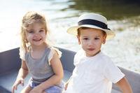 Happy kids sitting in boat