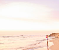 Girl and the sea at sunrise, travel and beach lifestyle