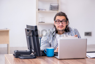 Young male it specialist working in the office