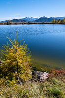 Peaceful autumn Alps mountain lake with clear transparent water and reflections. Reiteralm, Steiermark, Austria.