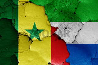 flags of Senegal and Sierra Leone painted on cracked wall