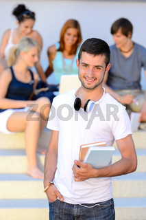 Smiling student boy friends sitting college steps