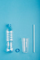 Empty plastic bottle, cup, straw and cap collected to recycling