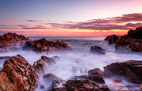 Rocky coastal seascape at dawn