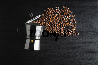 Coffee beans and bialetti coffee maker.  Moka pot