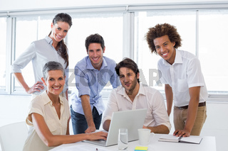 Business people working on laptop smile to camera