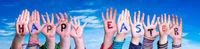 Children Hands Building Word Happy Easter, Blue Sky