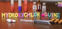hydroxychloroquine or HCQ drug in colourful letters on table used for malaria.