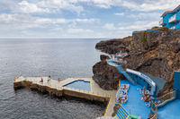 Hotel with swimming pool at rocky coast of Madeira Island