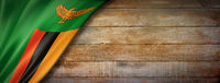 Zambian flag on vintage wood wall banner