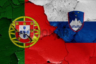 flags of Portugal and Slovenia painted on cracked wall