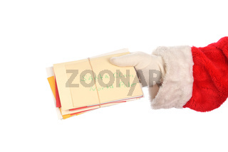 Santa Claus holding a bunch of Christmas letters from children. Hand only isolated on white.