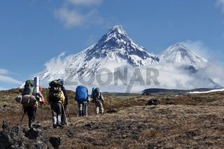 Hiking on Kamchatka: travelers go to mountains