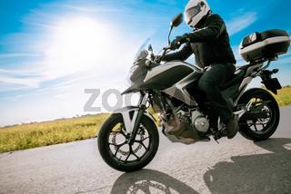 Biker in helmet road motorbike