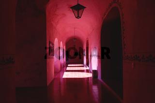 Corridor of the former monestary Convent de San Bernardino de Siena in Valladolid with sun light through arches, Yucatan, Mexico