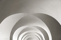 white arched ceiling with geometric shadows as background