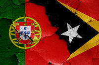 flags of Portugal and East Timor painted on cracked wall