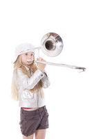 young girl with cap playing trombone