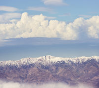 Snowy mountains with clouds