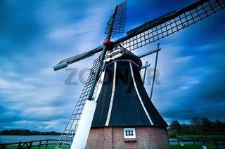 Dutch windmill over blurred sky