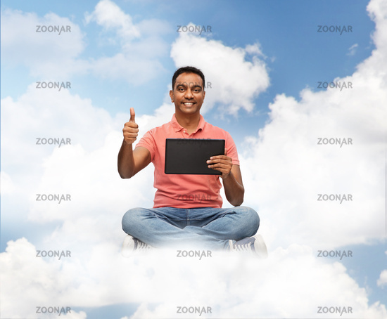 happy indian man with tablet pc showing thumbs up