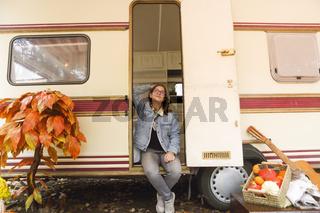 Teenager sitting in caravan